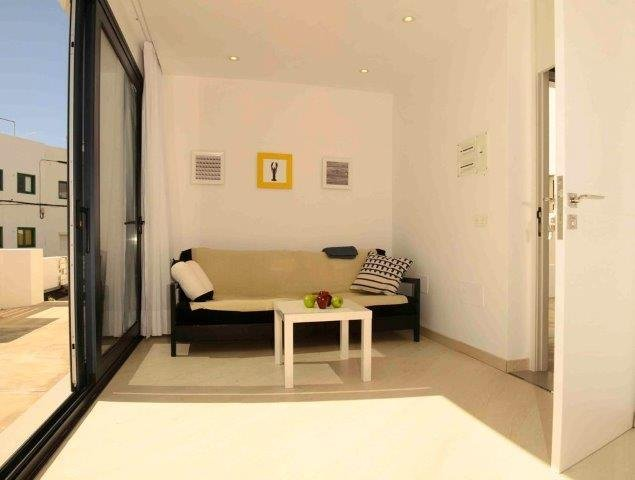 Appartementen Anclada - woonkamer begane grond